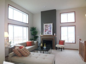 beautiful living room with high ceilings, big windows and fireplace!