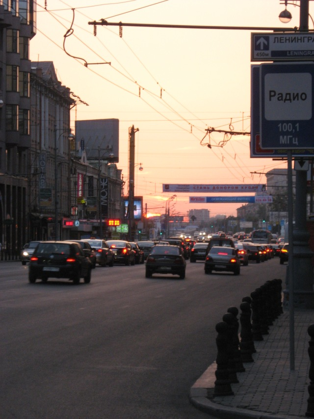 summer sunset over city traffic